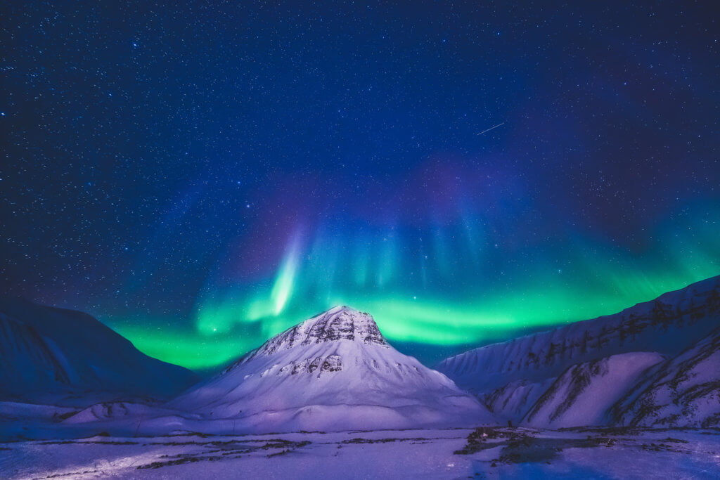The Polar Arctic Northern Lights hunting aurora borealis sky star in Norway travel photographer Svalbard in Longyearbyen city the moon mountains