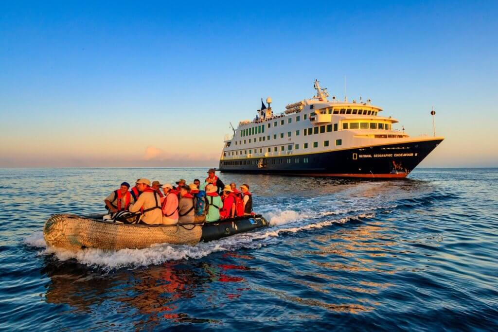 Expedition Cruising: Lindblad Cruiseship people in a zodiac in the ocean