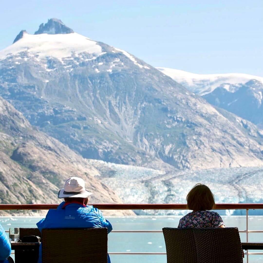 Couple sightseeing on an Alaskan Cruise